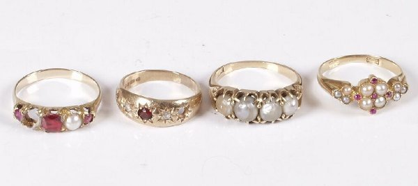 12: Four gold mounted dress rings set ruby, pearl and p