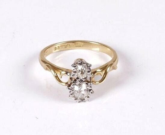 14: 18ct gold illusion set two stone old cut diamond ri