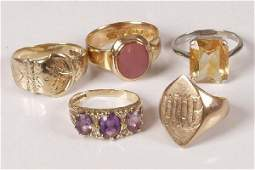 122: Five rings to include an 18ct gold stone set signe