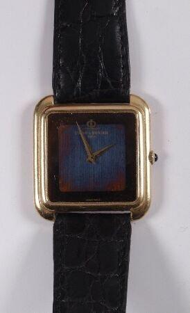 1002: BAUME & MERCIER -  a gentleman's 18ct gold square