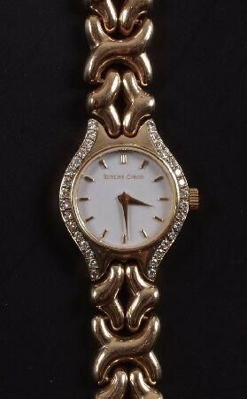 1012: BUECHE GIROD -  a ladies 9ct gold quartz watch  w