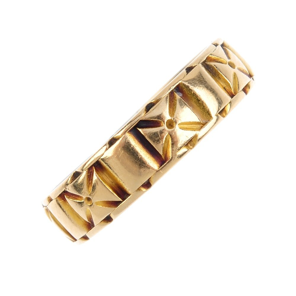 A late Victorian 18ct gold band ring. Designed as an
