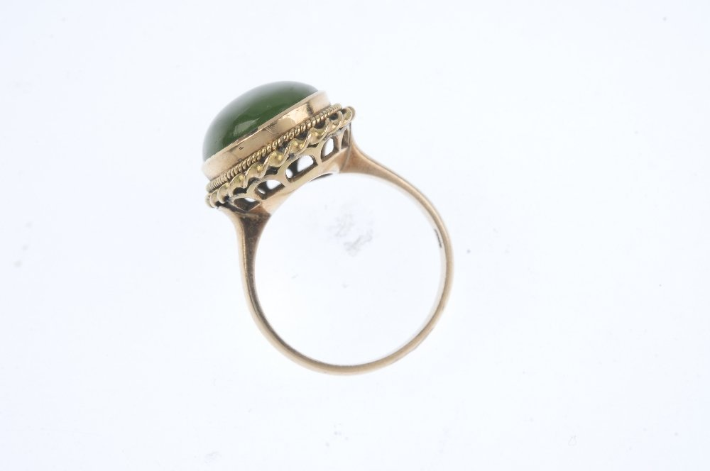 A jade single-stone ring. The oval jade cabochon, - 2