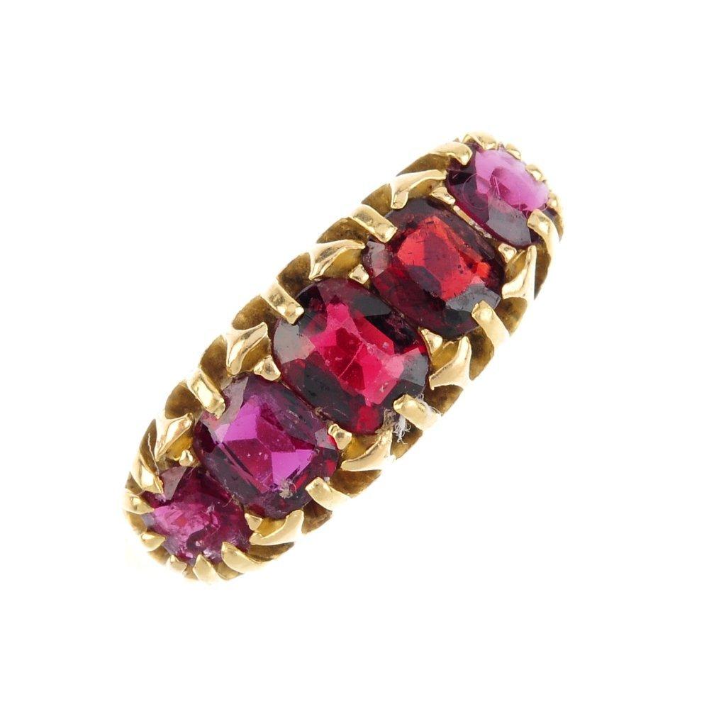 An Edwardian 18ct gold garnet five-stone ring. The