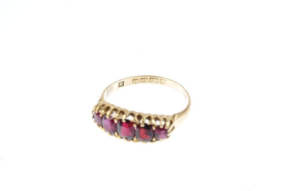 An Edwardian 18ct gold garnet five-stone ring. The - 3