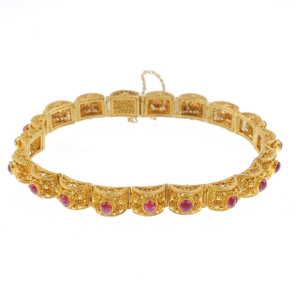 A ruby bracelet. Designed as a series of circular ruby
