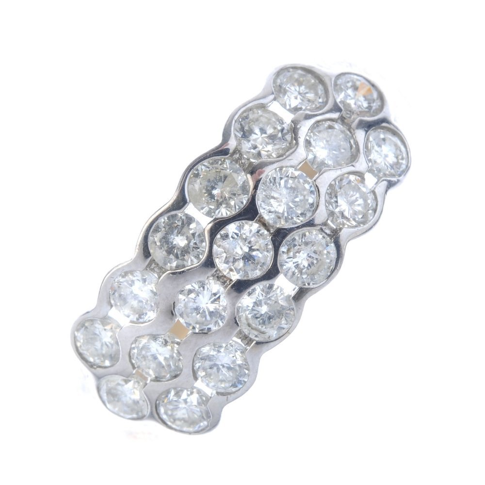 A 9ct gold diamond dress ring. Comprising three