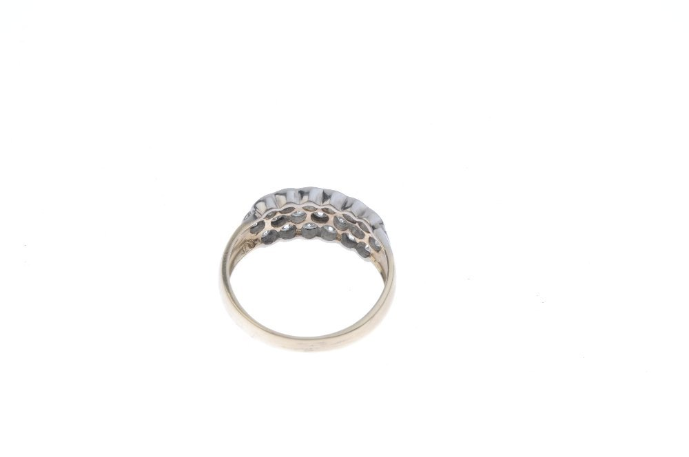 A 9ct gold diamond dress ring. Comprising three - 3