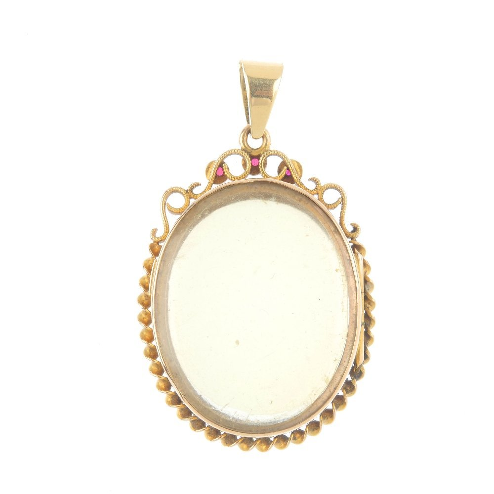 A ruby photograph locket. Of oval-shape outline, the - 2