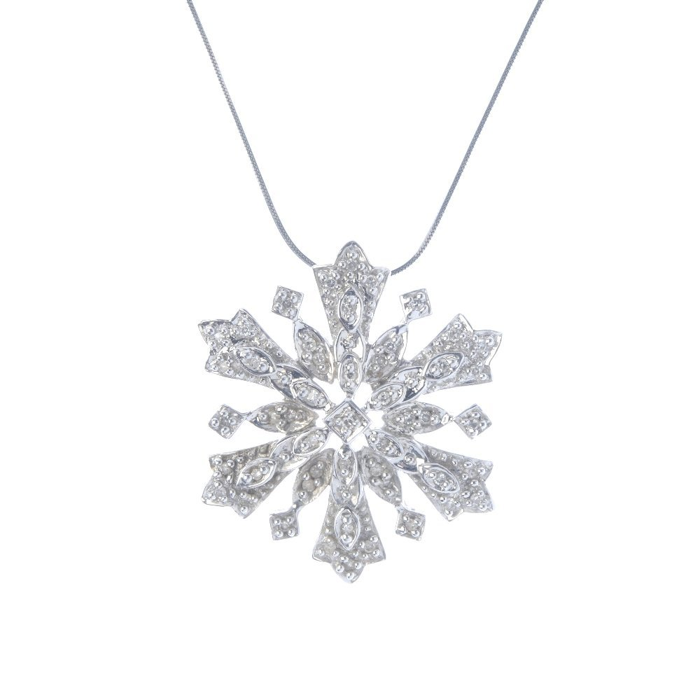A 9ct gold diamond snowflake pendant. The single-cut