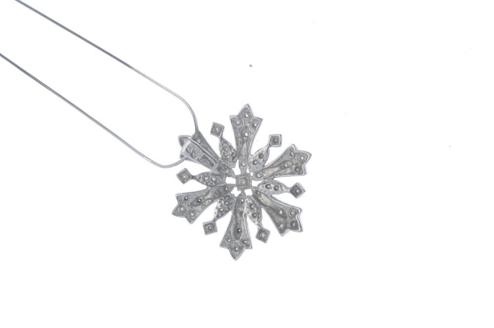 A 9ct gold diamond snowflake pendant. The single-cut - 2