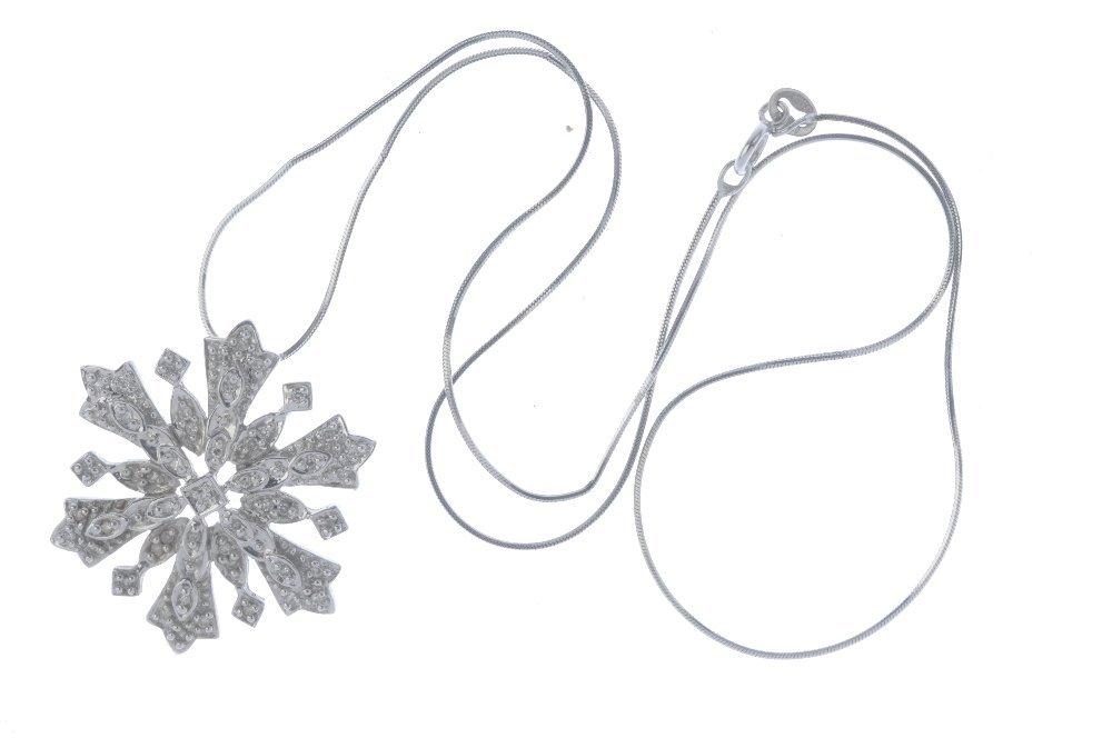 A 9ct gold diamond snowflake pendant. The single-cut - 3