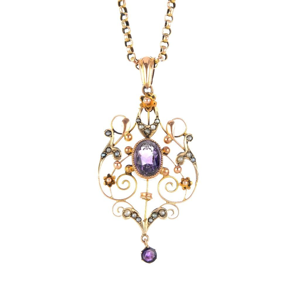 An early 20th century gem-set pendant. The oval-shape