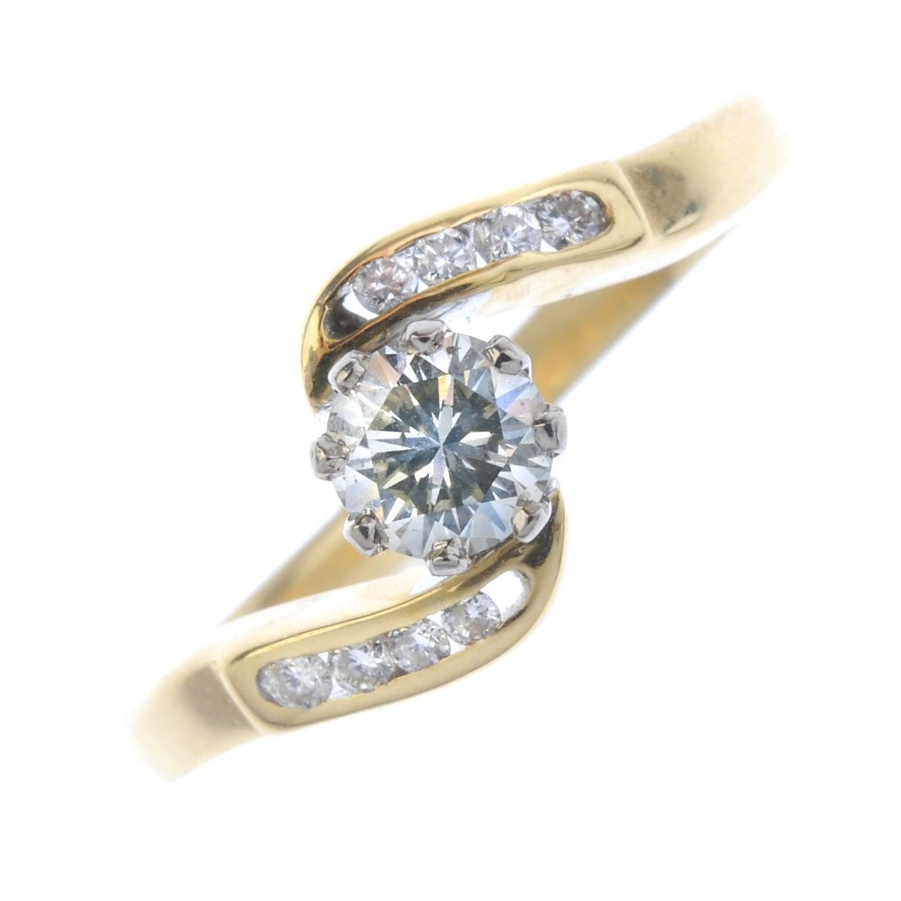 An 18ct gold diamond crossover ring. The brilliant-cut