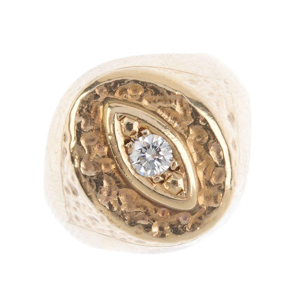 A diamond signet ring. The brilliant-cut diamond, with