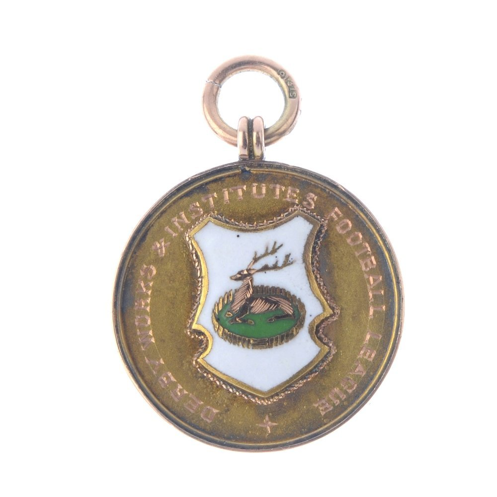 An early 20th century 9ct gold enamel sporting