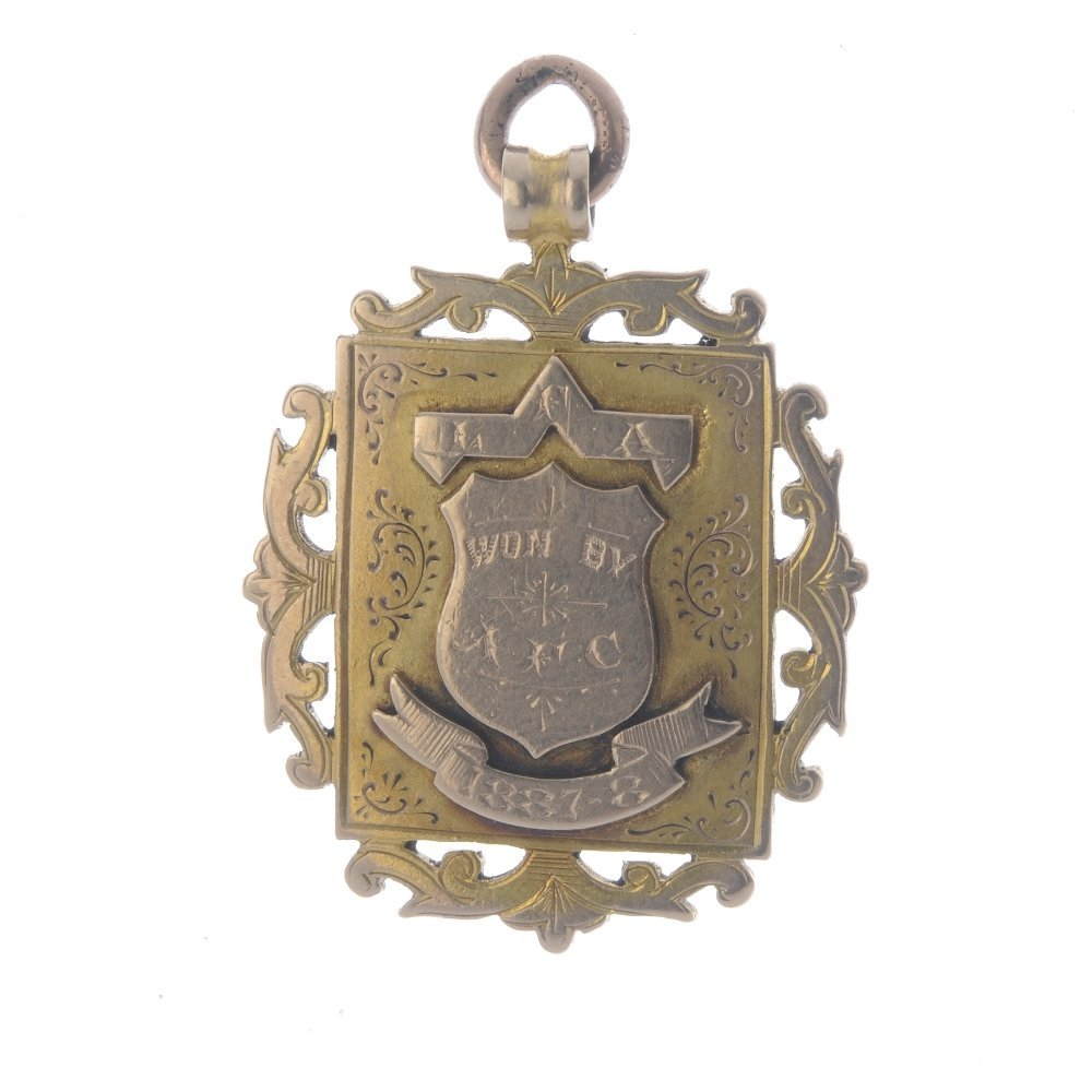 A late Victorian 9ct gold medallion. The rectangular
