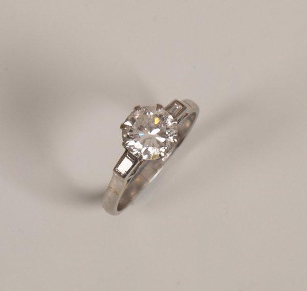 1: Platinum mounted single stone round cut diamond ring