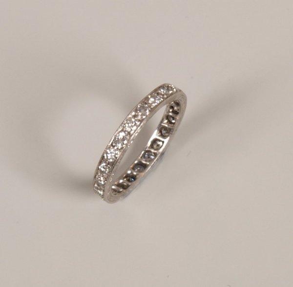 4: A round cut brilliant diamond set full eternity ring