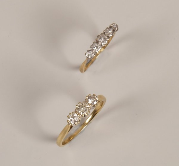 8: 18ct gold claw set three stone diamond ring of appro