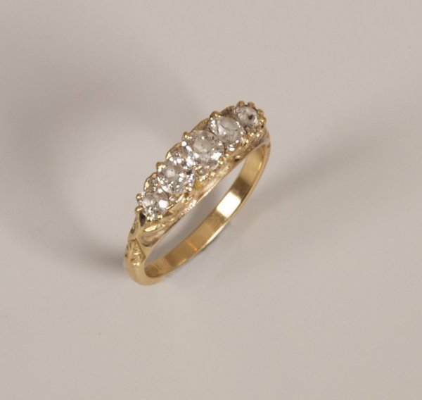 10: 18ct gold five stone old cut diamond carved half ho