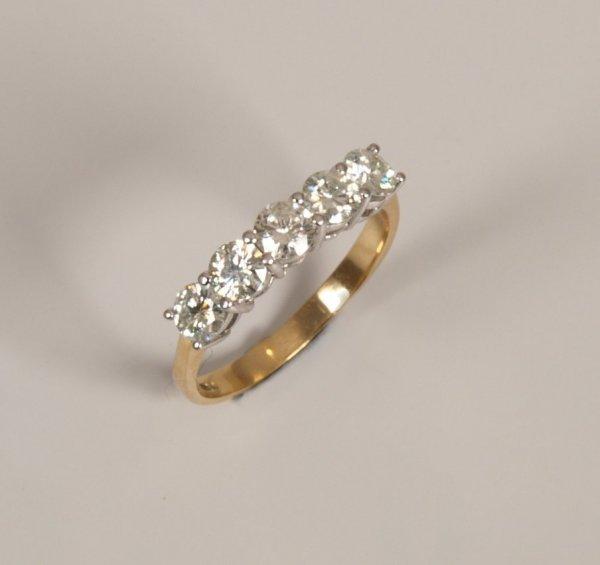 12: 18ct gold five stone round brilliant diamond half h