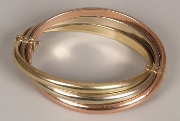 14: 9ct tri-colour gold hollow crossover bangle.  Weigh
