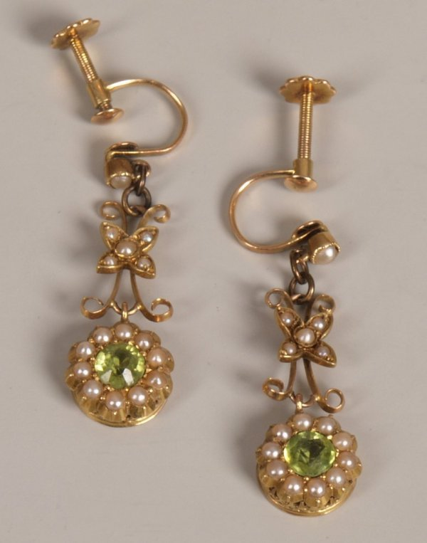 19: A pair of 15ct gold seed pearl and peridot set drop