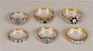97: Six rings to include an 18ct gold three stone diamo