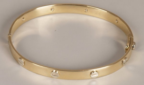 585: 9ct bi-colour gold Cartier style bangle with eight