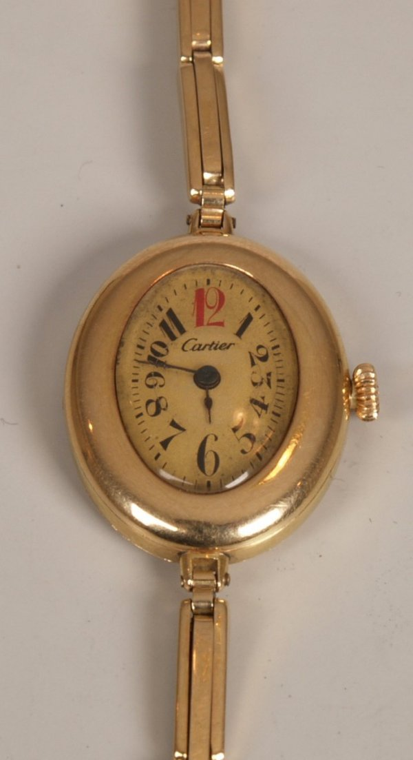 2017: CARTIER - A 1930's ladies 14k gold watch, with ov