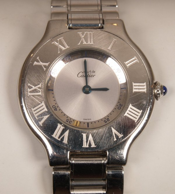 2018: CARTIER - a ladies all steel Must 21 with a silve