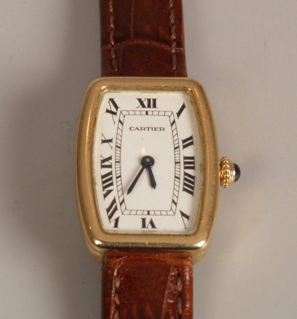 2020: CARTIER - A yellow gold lady's mechanical strap w
