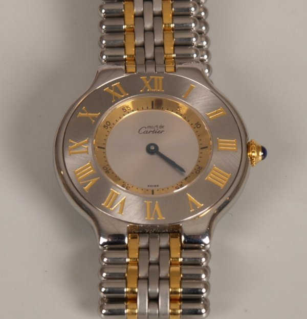 "2021: CARTIER - a ladies 18ct gold and steel ""Must 21"""