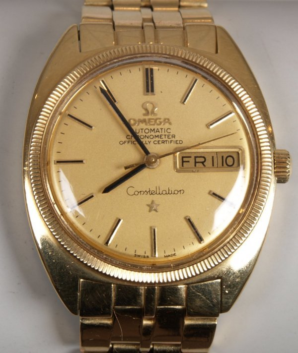 2102: OMEGA - a gentleman's 1960's 18ct gold automatic