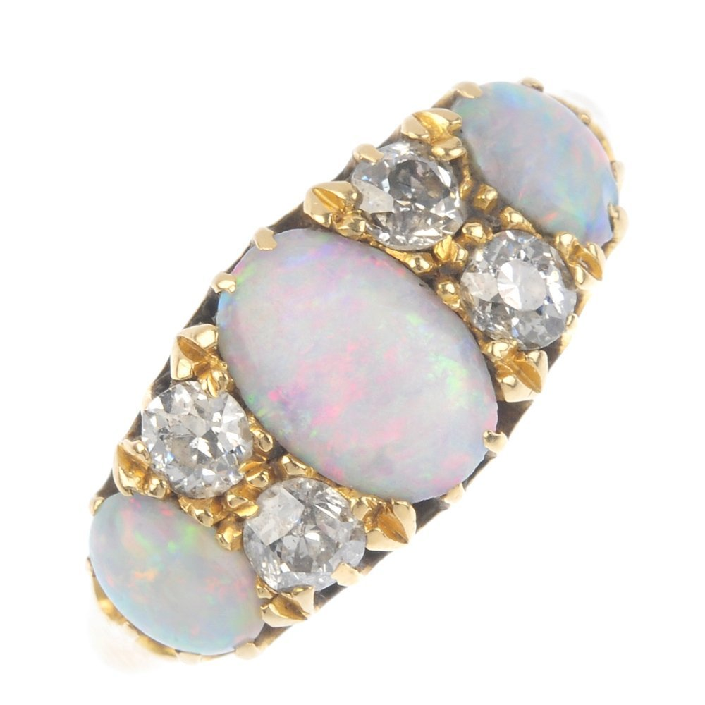 An early 20th century gold opal and diamond ring. The