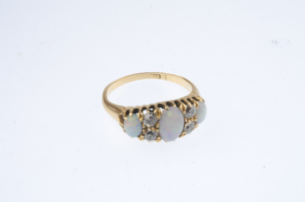 An early 20th century gold opal and diamond ring. The - 4