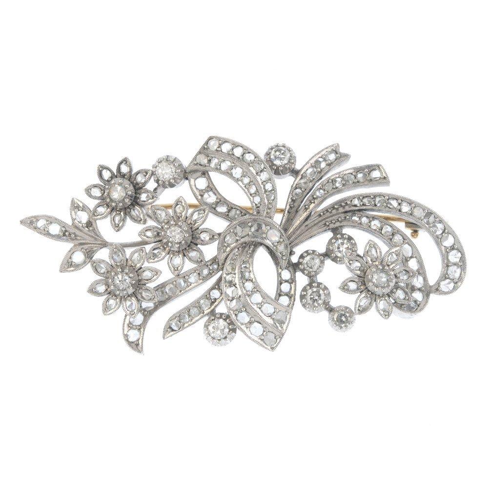 A diamond floral brooch. Designed as a rose-cut diamond