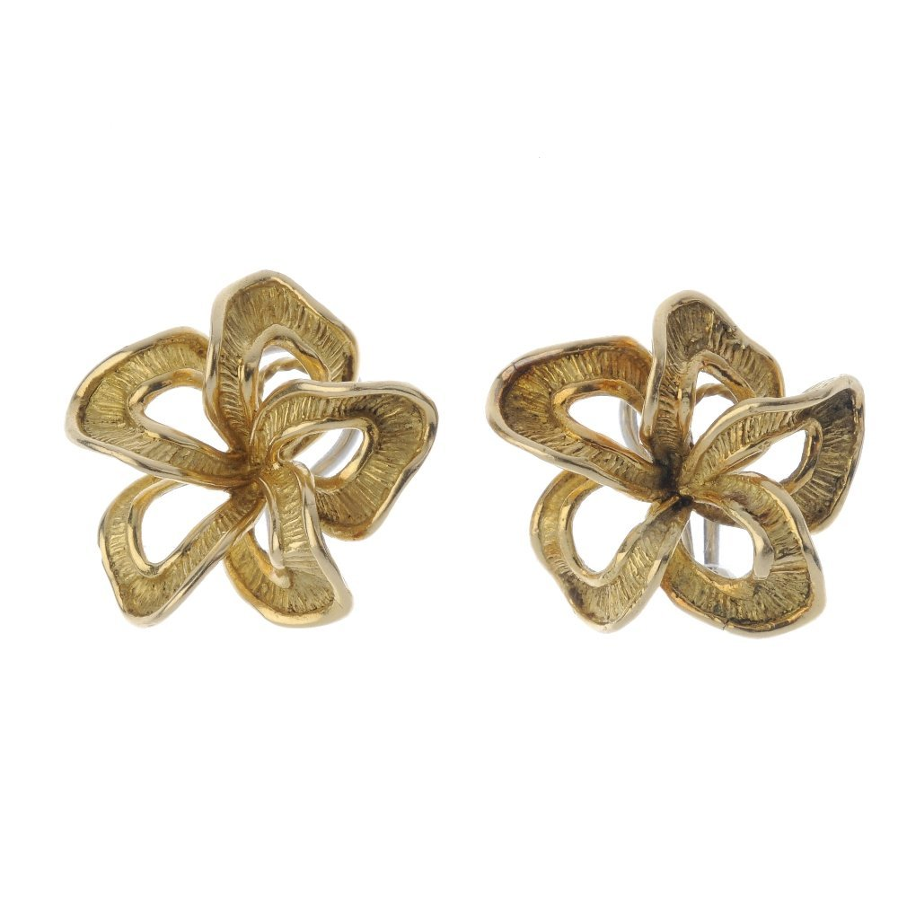 A pair of 1970s 18ct gold earrings. Each designed as an