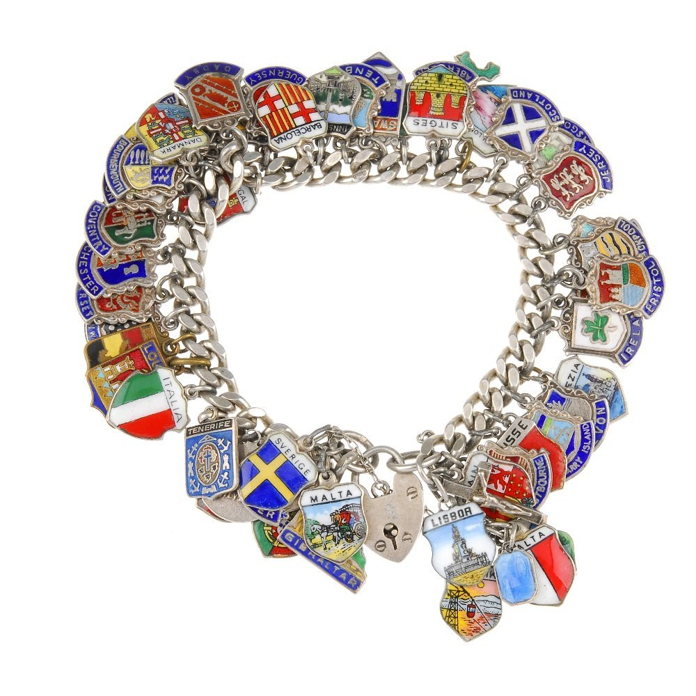 Three charm bracelets with mainly enamel tourist