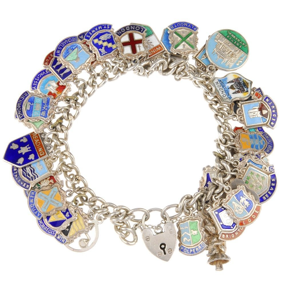 Two charm bracelets with mainly enamel tourist charms.