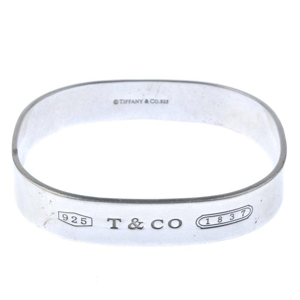 TIFFANY & CO. - a bangle. Of slight concave design,