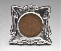 An Art Nouveau silver mounted photograph frame the