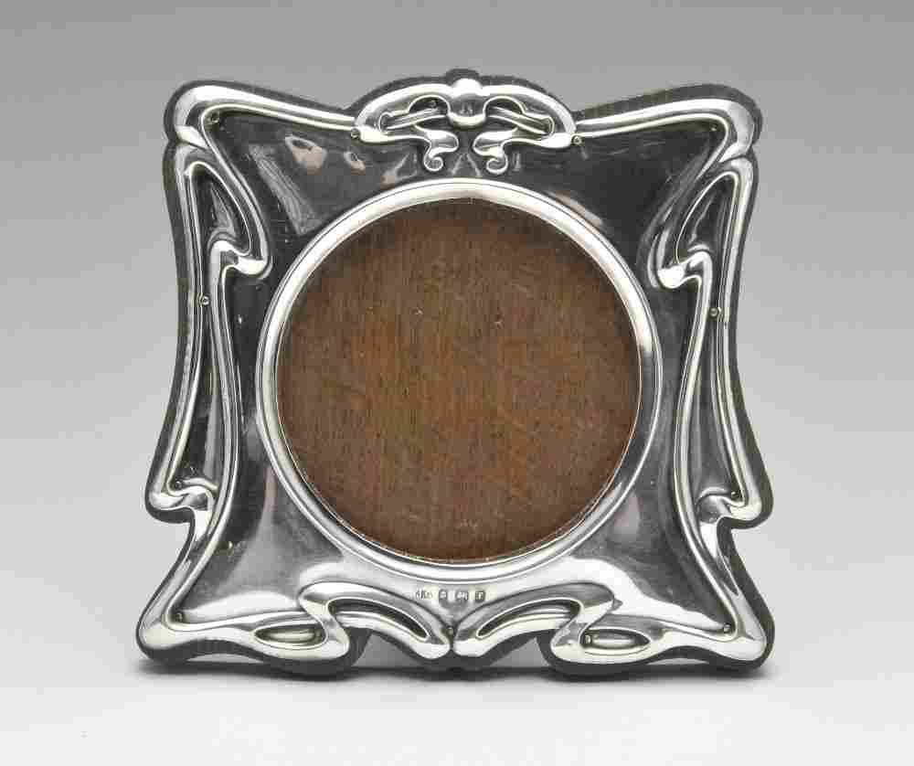 An Art Nouveau silver mounted photograph frame, the