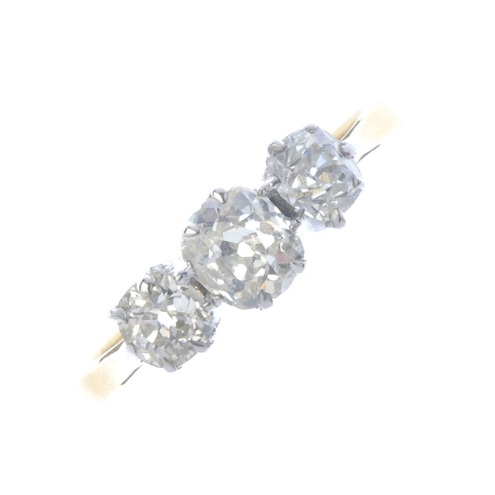 A mid 20th century 18ct gold diamond three-stone ring.