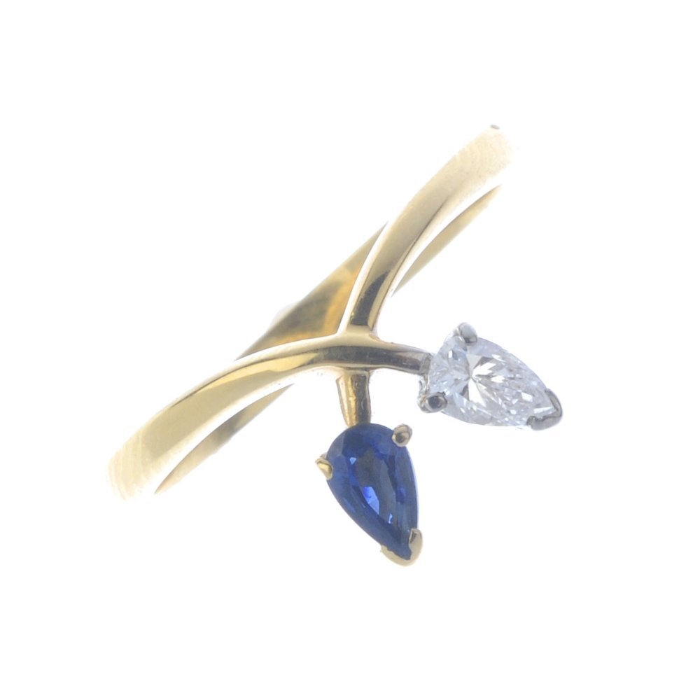 An 18ct gold diamond and sapphire dress ring. The
