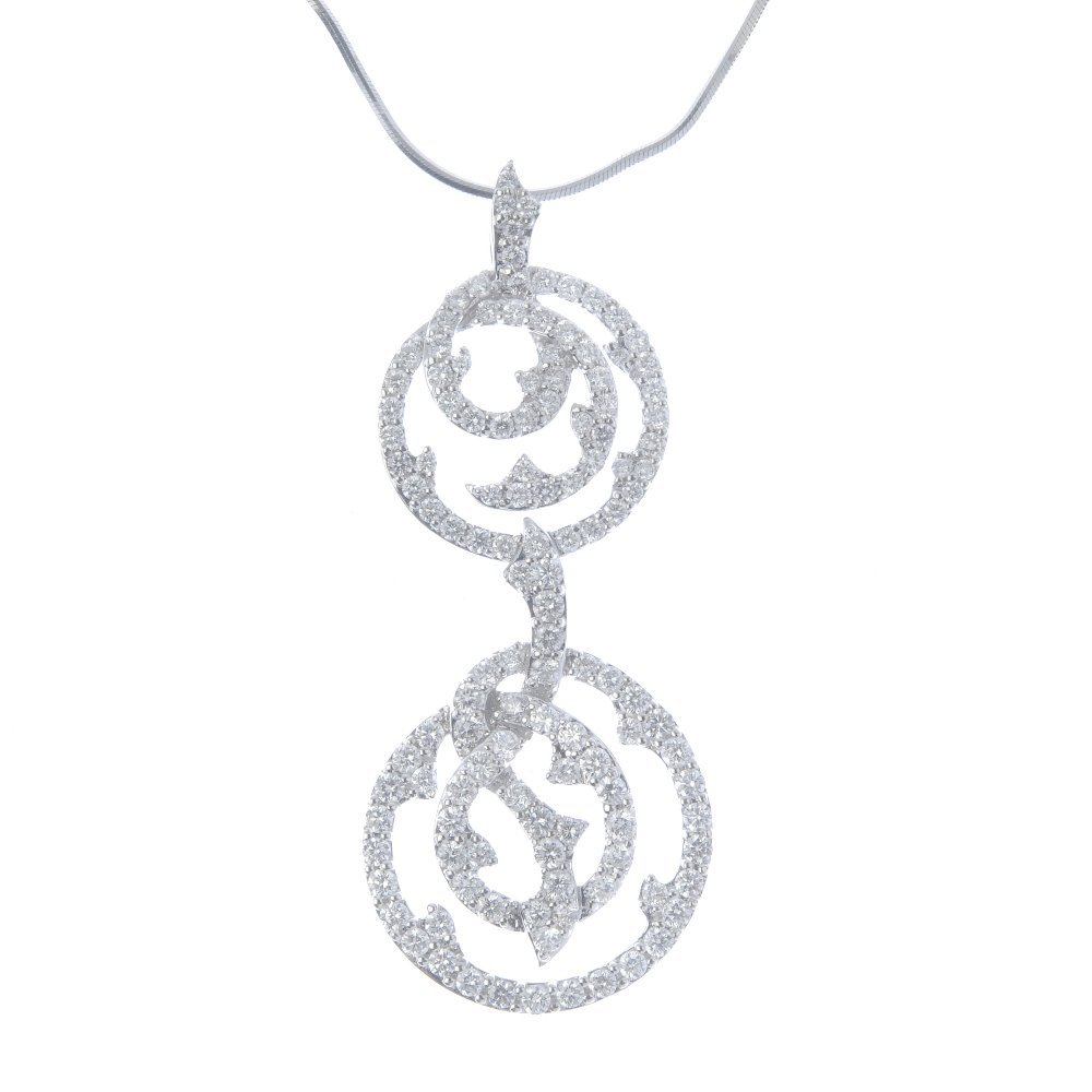 An 18ct gold diamond pendant. Designed as a
