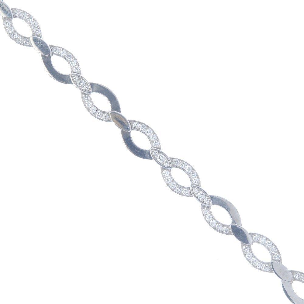 CARTIER - a diamond necklace. Designed as a series of