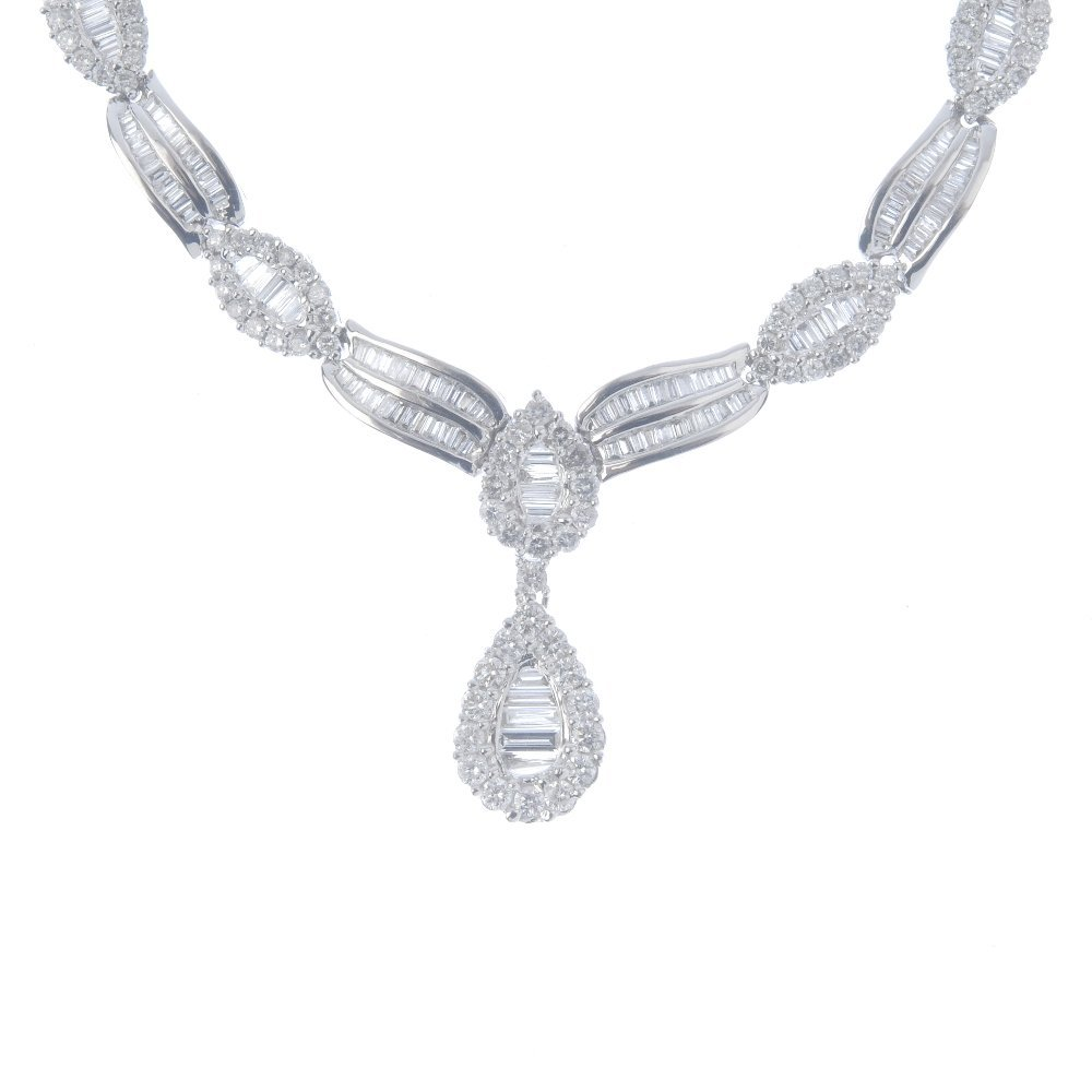 A diamond necklace. The baguette and brilliant-cut