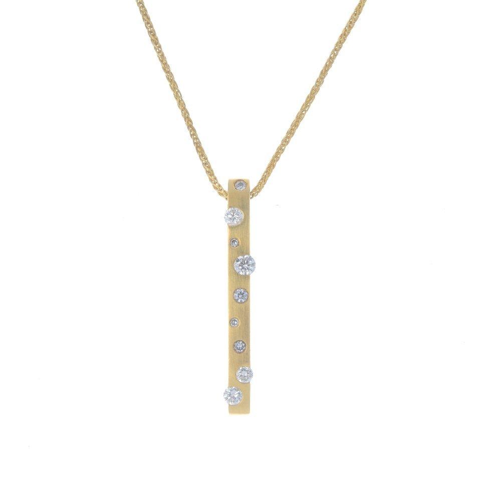 An 18ct gold diamond pendant. The slightly textured